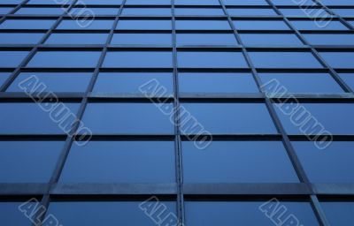 Blue glass panels of a skyscraper