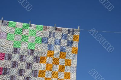 Patchwork counterpane on a clothes-line