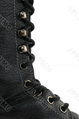 Closeup of black leather boot