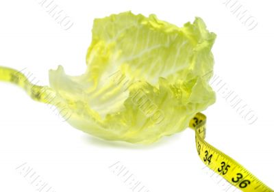 Healthy dieting - lettuce and measuring tape.