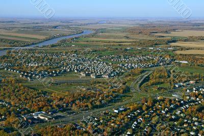 Aerial view of suburban neighborhood near highway
