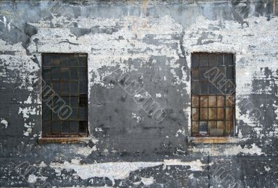 Grungy wall with two windows