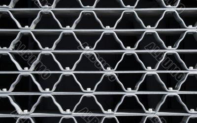 Wavy pattern of a metal grid