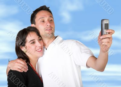 couple taking a pic with cell phone
