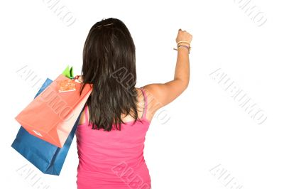 girl with shopping bags reaching for something