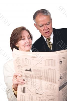 business partners reading financial paper