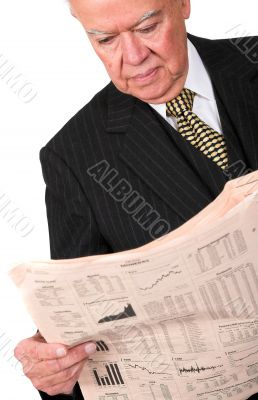 business manager reading newspaper