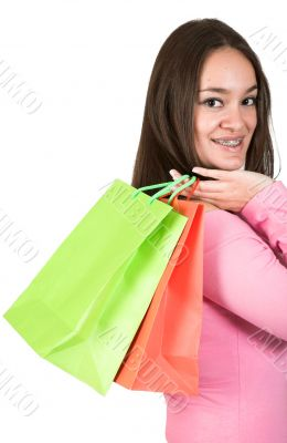girl in pink with shopping bags