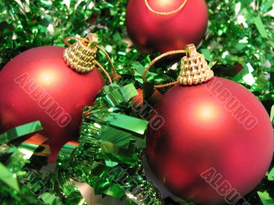 Red christmas balls on green glare