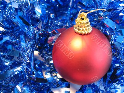 Red christmas ball on blue glare