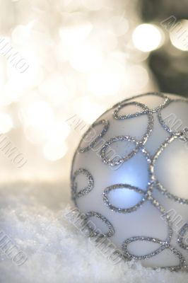 Christmas bauble with light in background