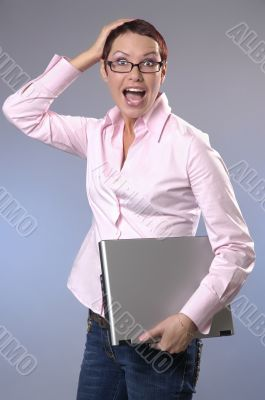 The shouting business woman with a computer