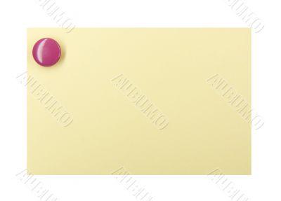 Pushpin on a yellow note