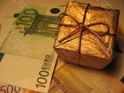 Golden christmas gift box and money
