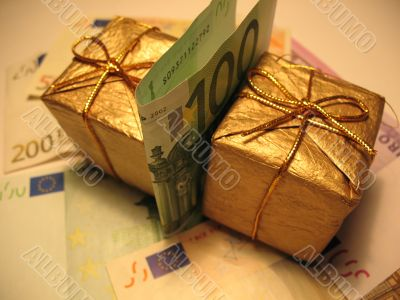 Two golden christmas gift box and money