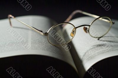 Book and reading glasses