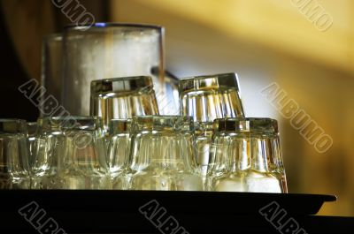 Stack of clean glassware waiting in a cafe