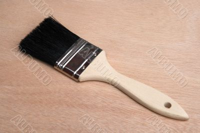 Paint brush on wood background