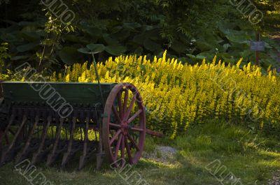 Antique seeder on a lawn.
