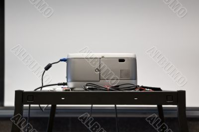 A projector and a screen.
