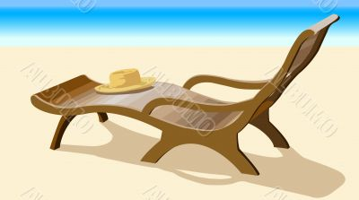 Chaise lounge and straw hat on coast of ocean
