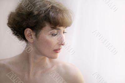Beautiful mature topless woman