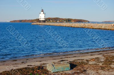 lighthouse, beach, and breakwater