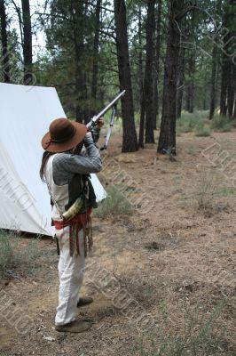 Mountain man preparing to fire
