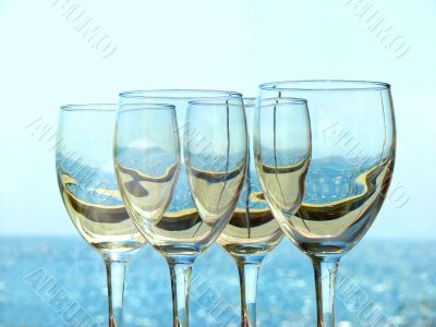 Wine glasses on a background of the sea