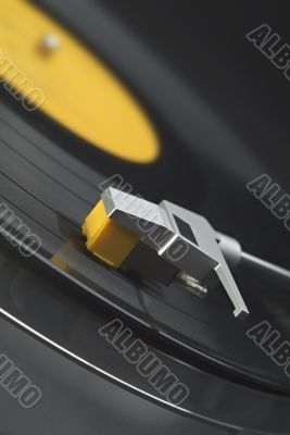 Vinyl record on turntable - tilted view