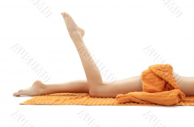 long legs of relaxed lady with orange towel 2