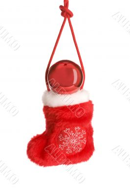 Red christmas sock on cord with red ball