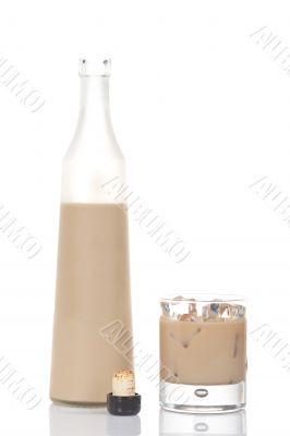 Whiskey cream bottle and glass