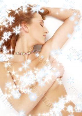 sleeping redhead with snowflakes