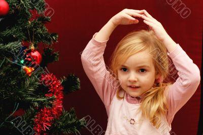 toddler girl and christmas tree