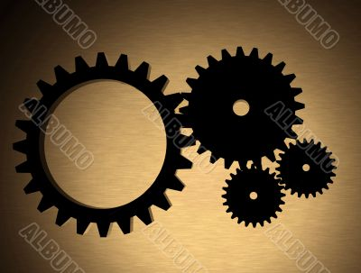 cogwheels over a gold metal texture