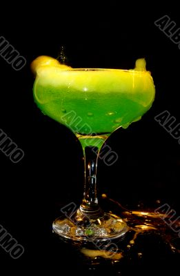cold green drink in transparent glass