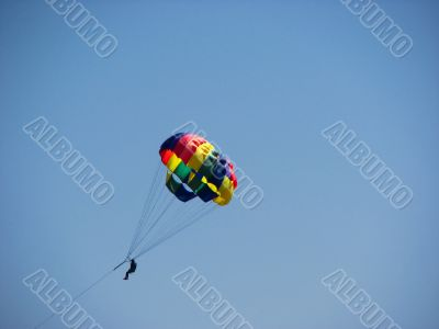 Man parasailing in the sky