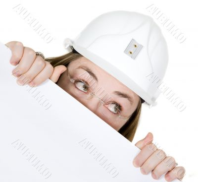 curious architect looking over white card