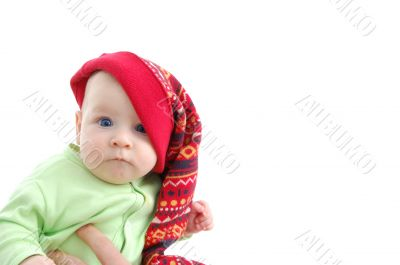 a little baby in a large red hut portrait