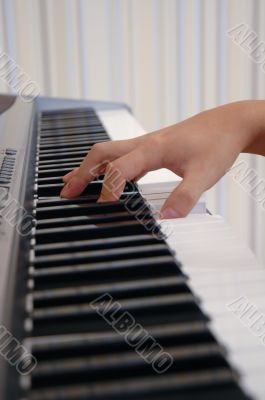 a hand playing piano