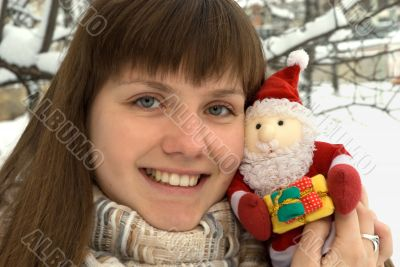The girl with toy Santa Claus