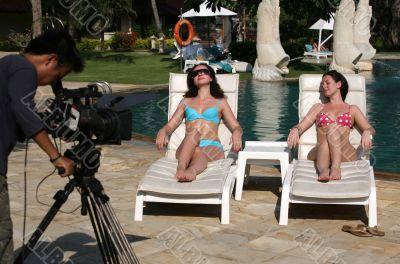Beautiful women and video-operator
