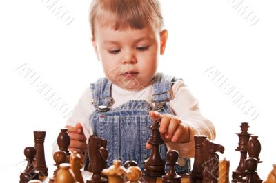 Baby girl playing chess