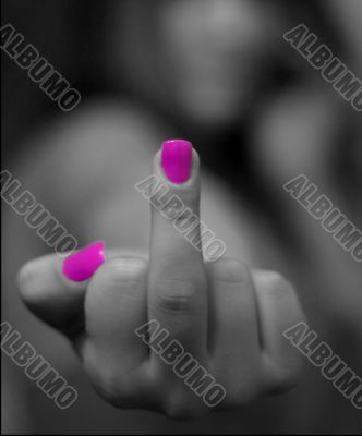 finger with pink nails `fuck off`