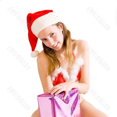 Sexy christmas girl presenting present