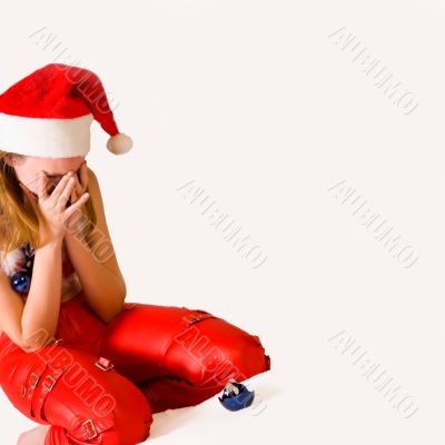 Crying faerie with broken christmas decoration
