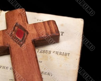 Vintage Bible and Wooden Cross