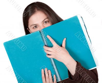 beautiful student hugging a notebook