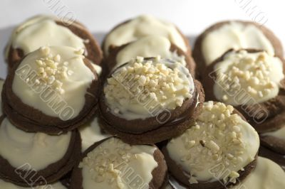 Chocolate cookies with nuts and frosting